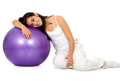Girl with a pilates ball Stock Photo