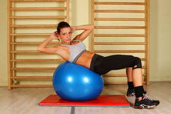 Girl with pilates ball Royalty Free Stock Photos