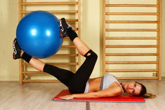 Girl with pilates ball Royalty Free Stock Photo