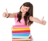 Girl with pile book showing thumb up. Royalty Free Stock Image