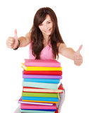 Girl with pile book showing thumb up. Stock Photography