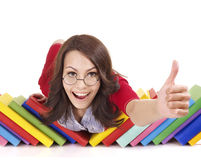 Girl with pile book showing thumb up. Stock Photo