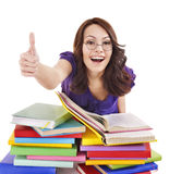 Girl with pile book showing thumb up. Royalty Free Stock Photo