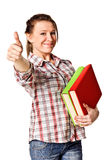 Girl with pile book showing thumb up Stock Photo