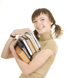 Girl with a pile of books Royalty Free Stock Photo