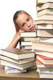 Girl with pile of books Stock Image