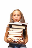 Girl with pile of books Stock Photography