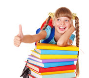Girl with pile of books  showing thumb up. Stock Photo