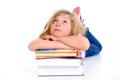 Girl on a pile of books Stock Images