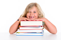 Girl on a pile of books Stock Photo