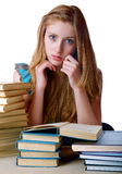 The girl with pile of books and writing-books Stock Photography
