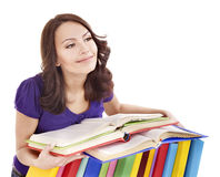 Girl with pile color book . Stock Image