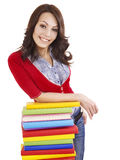 Girl with pile color book . Royalty Free Stock Photo