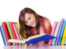 Girl with pile colored book. Royalty Free Stock Photography