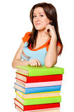 Girl with pile colored book Stock Photo