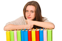 Girl with pile colored book Royalty Free Stock Image