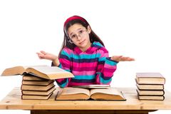 Girl with pile of old books showing ignorance. Confused girl with pile of old books showing ignorance, isolated on white Royalty Free Stock Photos