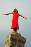 Girl on pillar column Stock Image