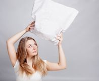 Girl and pillow Stock Photography