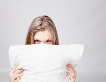 Girl and pillow Stock Photos