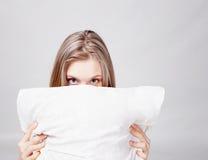Girl and pillow Stock Photos
