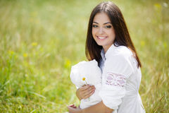 The girl with a pillow on the fresh spring grass. Royalty Free Stock Images
