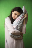 Girl with pillow isolated chroma key Stock Image
