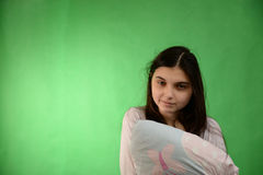 Girl with pillow isolated chroma key Royalty Free Stock Photos