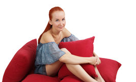 Girl with pillows. Royalty Free Stock Photography