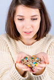 Girl with pills in hand Stock Photo
