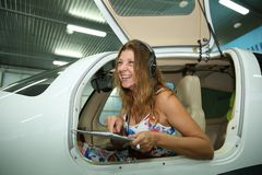 Girl pilots are ready to fly with a tablet royalty free stock photos