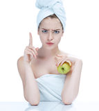 Girl with a pimply face holding apple. Royalty Free Stock Image