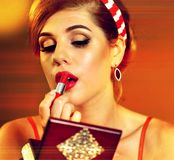 Girl in pin up retro style make make up. Royalty Free Stock Images