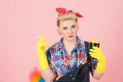 Coffee break after cleaning. Housewife in yellow rubber cloves with craft coffe cup stock photography