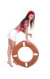 Girl pin up style, with a lifebuoy Stock Photos