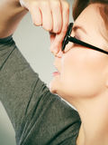 Girl pinches her nose because of stench stink. Stock Image