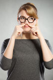 Girl pinches her nose because of stench stink. Royalty Free Stock Photo