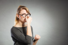 Girl pinches her nose because of stench stink. Bad smell concept. Young woman feels disgust pinches her nose with fingers because of odor stench unpleasant Stock Photo