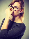 Girl pinches her nose because of stench stink. Bad smell concept. Young woman feels disgust pinches her nose with fingers because of odor stench unpleasant stock photos