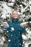 girl in a pine forest during a snowfall Royalty Free Stock Photos