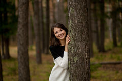 Girl in a pine forest Royalty Free Stock Photography