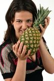 Girl with pineapple Stock Photography