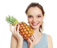 Girl with a pineapple Royalty Free Stock Photos