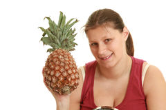 Girl with pineapple Royalty Free Stock Photos