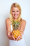 Girl with pineapple Stock Images