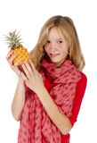 Girl with pineapple Royalty Free Stock Photography