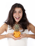 Girl with pineapple Stock Image
