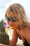 Girl with pineapple coctail Stock Images