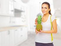 Girl with pineapple at ligth room Stock Photo