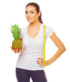 Girl with pineapple and measurement tape isolated Royalty Free Stock Image